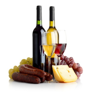 Wine, grapes, cheese an sausage isolated on white